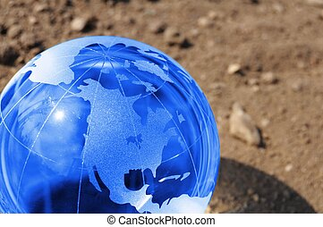 climate change concept with earth planet on dry soil and...