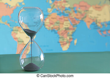 Climate change with time running out as depicted by a hour glass .