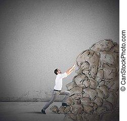 Climb the success - Tired businessman struggling to climb...