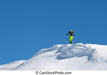 Climb with mountain skis and seal skins on a ridge