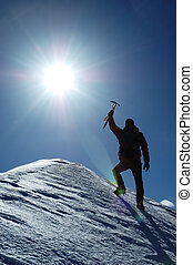 Climber - A lonely climber reaching the summit of the...