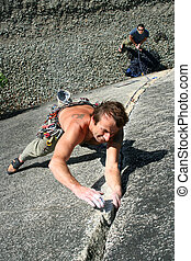 Climber - A rock climber leads a strenuous pitch.