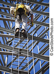 Climber ascending cell phone tower