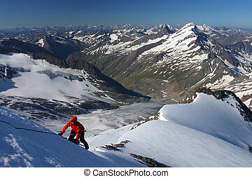 Climber ascending snow slope in the Austrian Alps