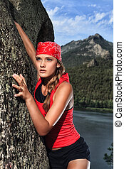 climber - Beautiful woman alpinist is climbing on a mountain...