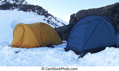 Climber Camping - High-altitude camp in a snow mountain....