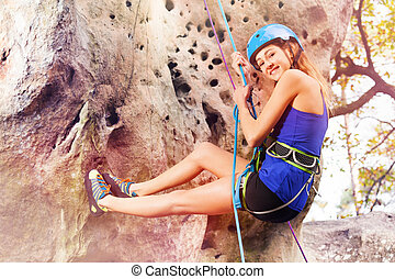 Climber holding harness rope during downclimb