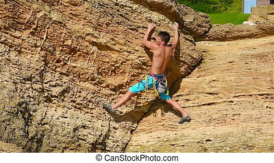 Climber Man Climbing On Yellow Mountain