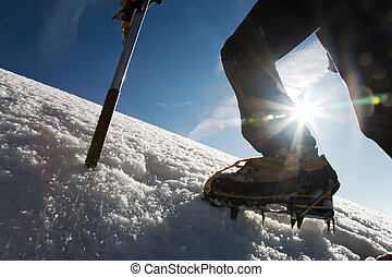 Climber - Mountain climber: detail on boot with ice crampon...