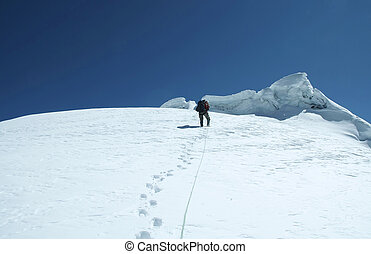 Climber on the peak - The climb on the Cordilleras...