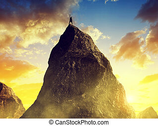 Climber on the top of the mountain. - Climber on the top of...