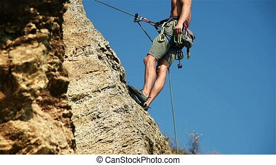Climber Shows Thumb Up - Climber Hanging On The Rock And...