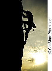 Climber - Silhouette of climber at the sunset. Element of...
