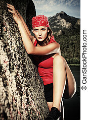 climber woman - Beautiful woman alpinist is climbing on a...
