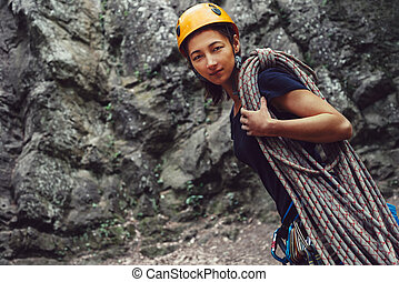 Climber woman standing with rope outdoor