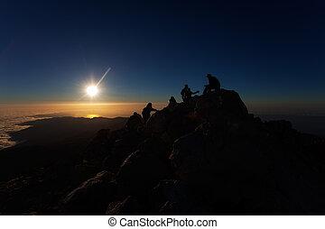 climbers at sunrise