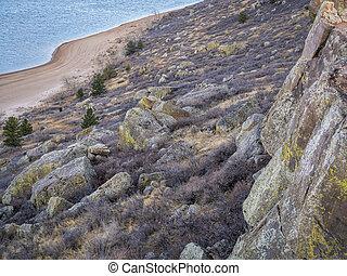 climbing cliff over mountain lake