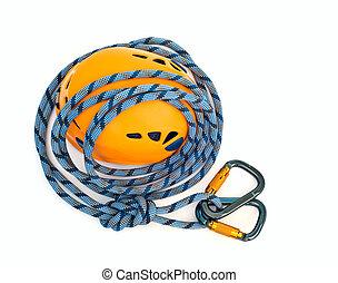 climbing equipment - carabiners, blue rope and helmet