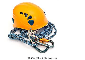climbing equipment - carabiners, helmet and blue rope