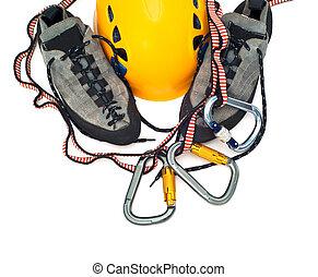 climbing gear - carabiners, helmet, rope, shoes