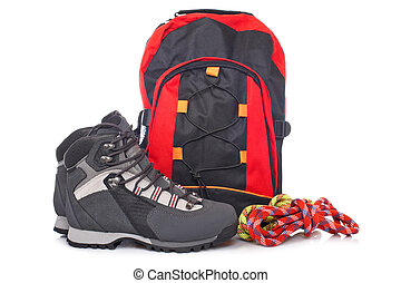 Hiking boots, two rope and backpack reflected on white background
