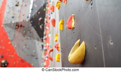 Climbing gym. Colorful footholds for training. - Climbing...