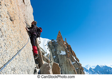 Climbing in Chamonix. Climber on the stone wall of Aiguille du M