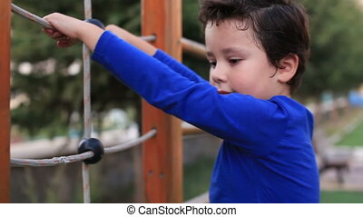 climbing - little child climbs in the park