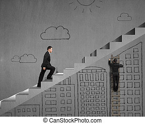 Climbing on stairs with man drawing on wall