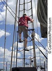 Climbing Rigging - Young Man Climbing Up The Ship's Rigging