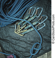 Climbing rope and carabiner on wooden boards