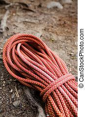 Climbing Rope - A climbing long orange climbing rope coiled...