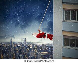 Climbing Santa Claus - Santa Claus climbs up a building...
