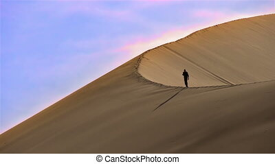 Climbing the Sand Dune - With a huge sand dune wind blows...