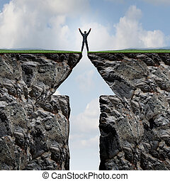 Climbing to success concept on a mountain and reaching the peak and summit as a businessman with arms in the air standing on top of two cliff sides shaped as an arrow symbol.