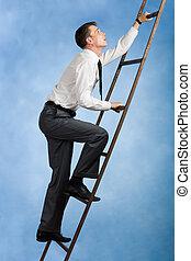 Climbing upwards - Photo of young businessman climbing...
