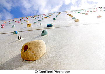 Climbing Wall - Detail of a climbing wall with a hold in the...
