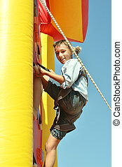 climbing wall - Youngster's effort in climbing wall to reach...