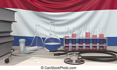 Clinic laboratory equipment on flag background. Healthcare and medical research in the Netherlands related conceptual 3D rendering