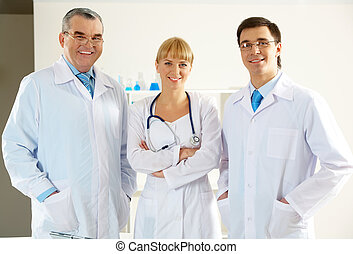 Clinicians - Portrait of friendly therapists standing in ...