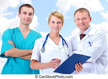 Clinicians - Portrait of friendly therapists standing in...