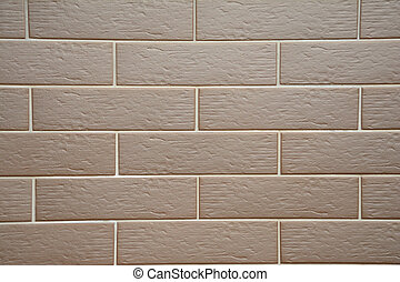Clinker tiles on house wall - background.