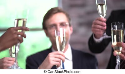 Clinking glasses with champagne at a business meeting