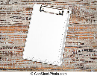 Clip board on wood  background .