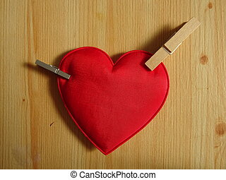 Clipped Red Heart on a Wooden Background