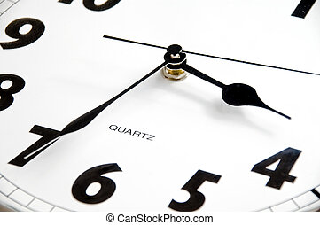 Detail of modern black & white clock. Time is 3:35 AM or PM