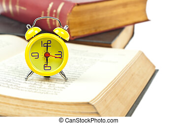 Clock and book as time management concept