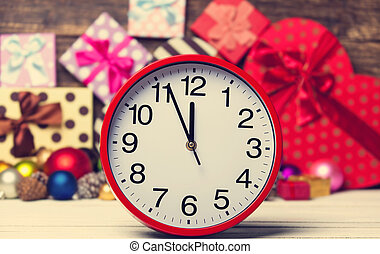 Clock and Christmas toys.