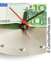 clock and euro bills - euro bill on a metal wall clock on...
