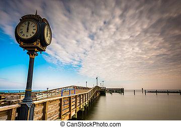 Clock and pier at Chesapeake Beach, Maryland. - Clock and...